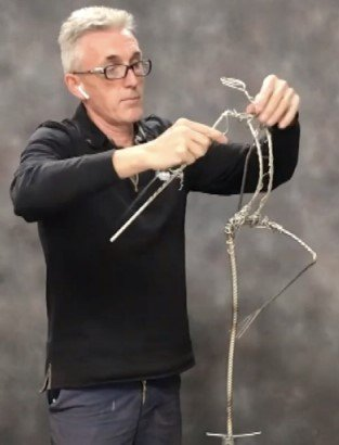 Robin Wight making wire artwork